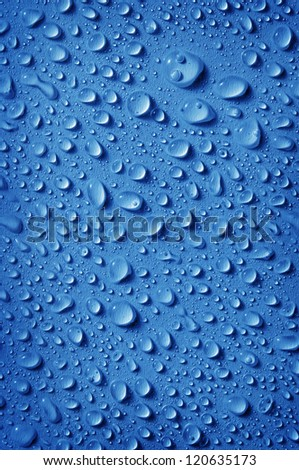 background of fresh water drops, in blue color - stock photo