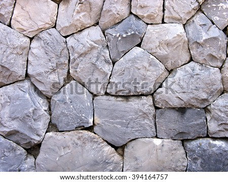 Background of gray stone wall texture, Arrange a gray stone wall. - stock photo