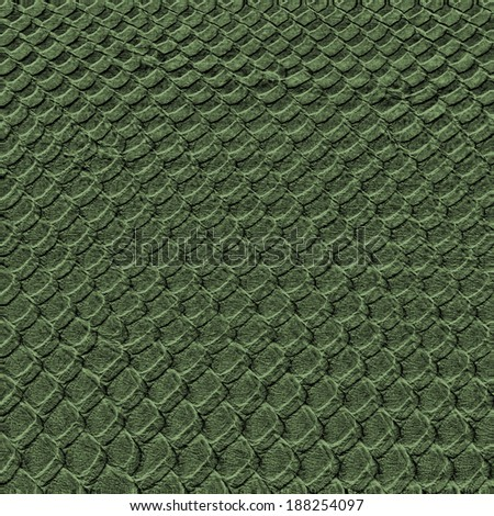 background of green reptilian skin closeup - stock photo
