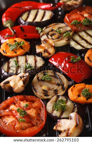 Background of grilled vegetables on the grill close up. vertical top view  - stock photo