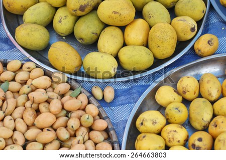 background of local fruit in trays at a local market - stock photo