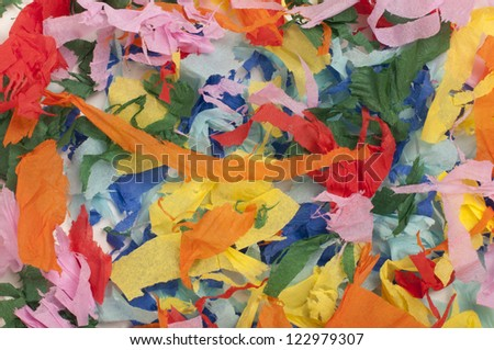 Background of many colorful pieces of torn paper - stock photo
