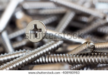 Background of many silver screws - stock photo