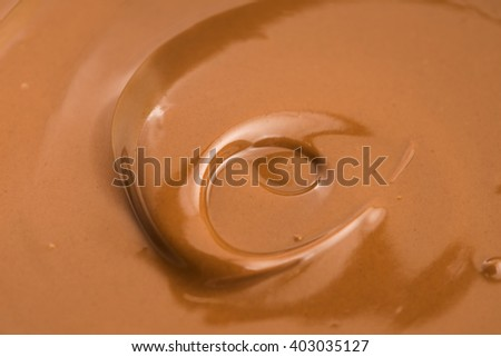 Background of melted milk chocolate - stock photo