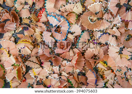 Background of multicolor pencil shavings. Close up colorful pencil shavings for background. Dynamic, abstract, horizontal composition of pencil sharpening shavings, close up, macro - stock photo