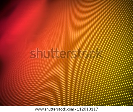 Background of multiple yellow dots fading to red - stock photo