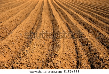 Background of newly plowed field ready for new crops - stock photo