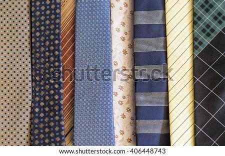 Background of numerous men's ties - stock photo