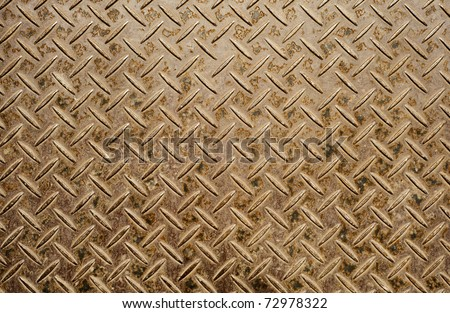 Background of old and grungy metal diamond plate in brown color. - stock photo