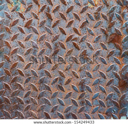 Background of old metal diamond plate in brown color. - stock photo