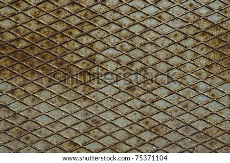Background of old metal diamond plate in brown color - stock photo