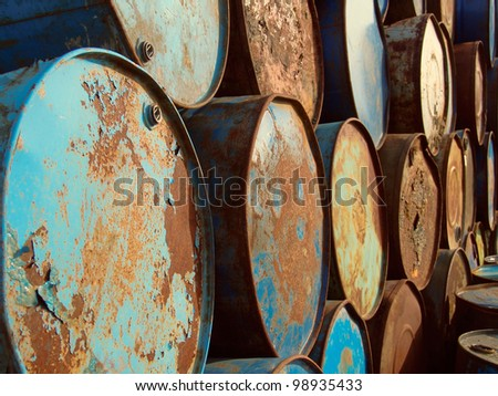 background of old rusty barrels lying on each other - stock photo