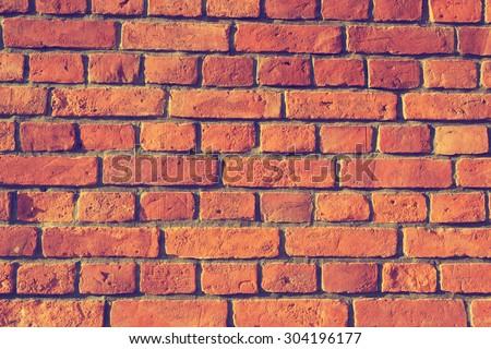 Background of old vintage brick wall , brick wall closeup - stock photo
