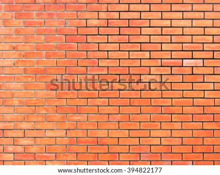 Background of old vintage orange brick wall, new paint old brick wall, strong brick wall for background texture - stock photo