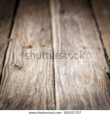 Background of old weathered wooden boards with a diminishing perspective and shallow dof in square format - stock photo