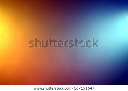 Background of orange and blue color lights shining through fog - stock photo