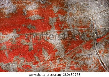 Background of peeling paint and rusty old red metal. - stock photo