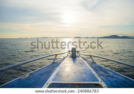 Background of poop Luxury white blue sail yacht catamaran boat in sea ocean water texture and blue sky with clouds Empty copy space for inscription - stock photo