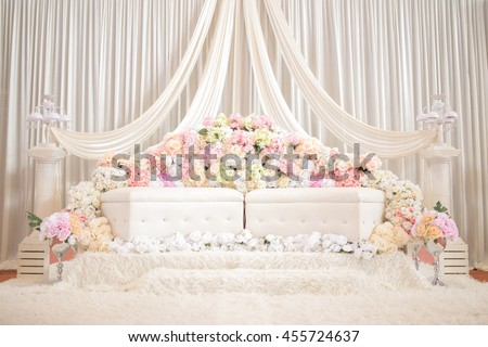 background of raised stage where the bride and bridegroom sits in a traditional English wedding with colorful flower - stock photo
