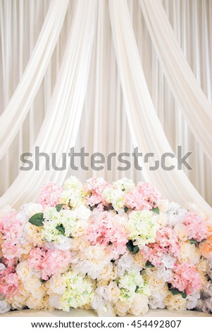background of raised stage where the bride and bridegroom sits in a traditional Malay wedding with colorful flower - stock photo