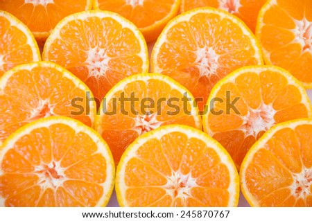 background of ripe and freshly sliced  tangerines - stock photo