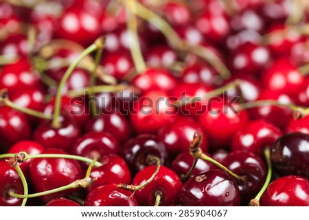 Background of ripe, fresh, juicy cherry closeup - stock photo