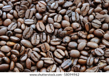 Background of roasted beans of black coffee - stock photo
