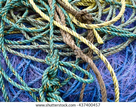 Background of ropes and fishing nets; background of ropes and fishing nets  - stock photo