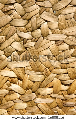 Background of rustic interlaced straw - stock photo