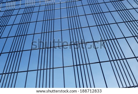 background of security fencing against blue sky - stock photo