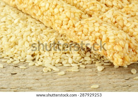 Background of sesame seeds scattered on wooden table at the top - stock photo