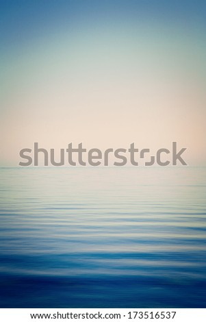 Background of sky and sea, sea is very calm with gentle ripples, with an instagram effect - stock photo