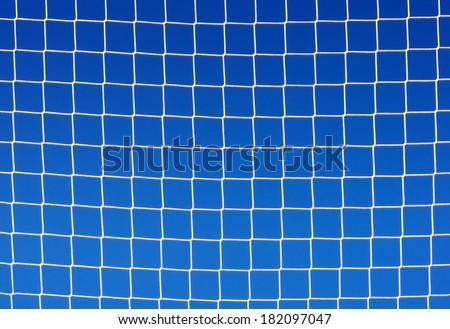 background of soccer net against blue sky - stock photo