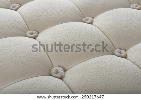 Background of soft comfortable quilted white mattress - stock photo
