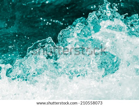 background of stormy water with splashes - stock photo