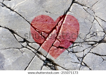 Background of strange rocks and sharp stones with red heart - stock photo