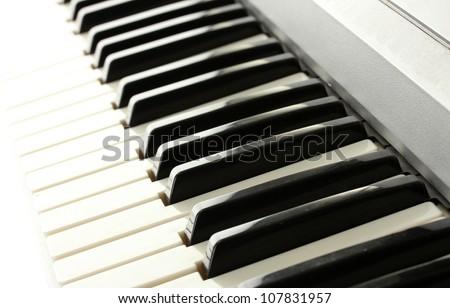 background of synthesizer keyboard - stock photo