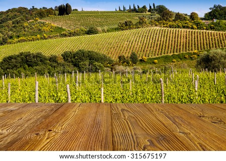 Background of the boards connected with a beautiful Tuscany landscape of vineyard - Italy - stock photo