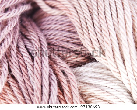 Background of the brown and beige knitted yarn close up. - stock photo