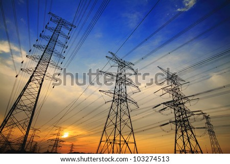 Background of the high-voltage tower in the sunset - stock photo