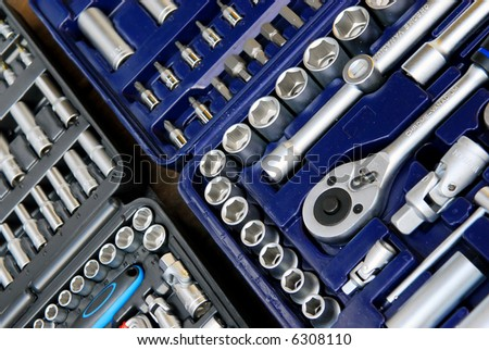 background of the interior of a toolbox filled with lots of tools - stock photo