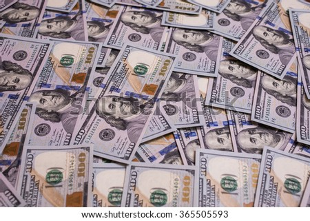 background of the money, hundred dollar bills front side. background of dollars, new hundred-dollar bill, the evolution of the bill in one hundred dollars, become a millionaire  - stock photo
