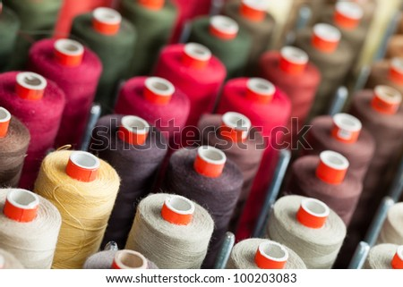 Background of the reels with colorful threads - stock photo
