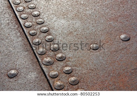 background of the rivets on rusty metals - stock photo
