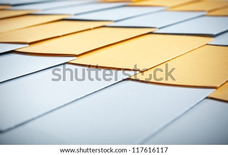 background of the series of gold and silver envelopes - stock photo