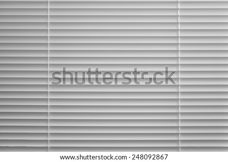 Background of the slats of venetian blind in black and white - stock photo