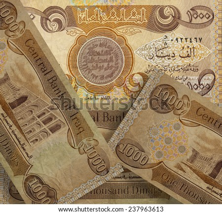 Background of thousands of Iraqi banknotes - stock photo