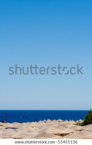 background of umbrellas on tropical beach - stock photo