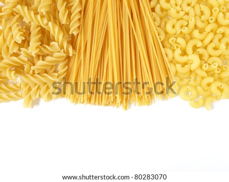 Background of uncooked Italian pasta Spaghetti, Fusili and Macaroni - stock photo