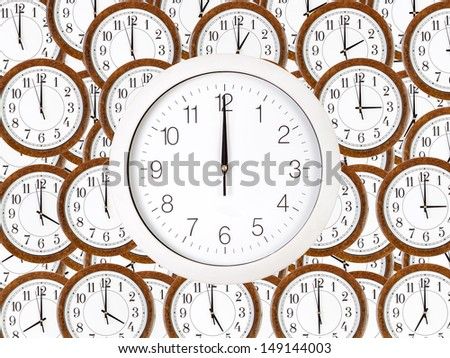 Background of wall clocks with brown wooden frame with white clock face over showing twelve  - stock photo